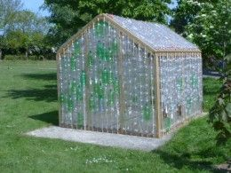 Plastic Bottle Greenhouse: 2-liter plastic bottles, X-acto knife, bamboo canes, wooden frame, fencing nails, and hammer.