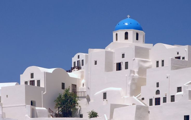 The island of Santorini in Greece is famous for its whitewashed, cubist houses that cling to the cliffs.