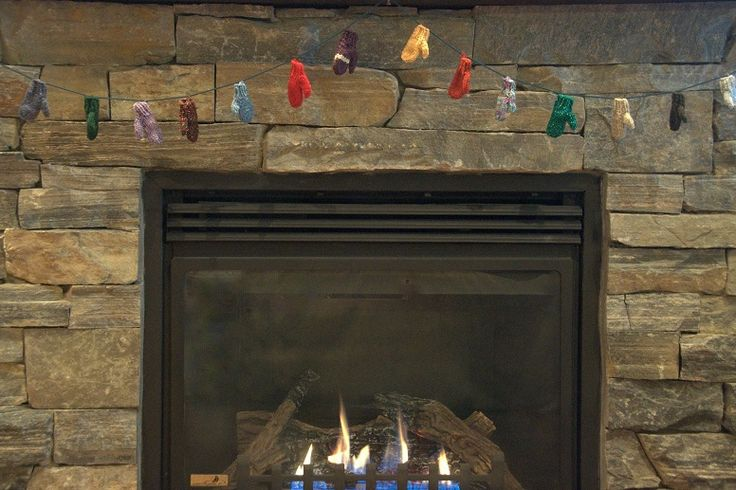 Garland of Merry Mittens over the fireplace.