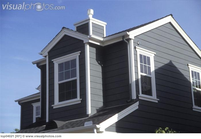Dark Grey Fiber Cement Siding With White Trim And Black