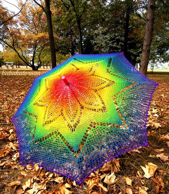 Solaster Rainbow Crochet Lace Parasol. Made of sewing thread this SUNbrella is pretty lace weight. I choosed a star shape to modify and created as blended as possible for showing better the gorgeous motif of this vintage star doily pattern.    Colors are going from pink to purple accross red, orange, yellow, neon green, teal and blue