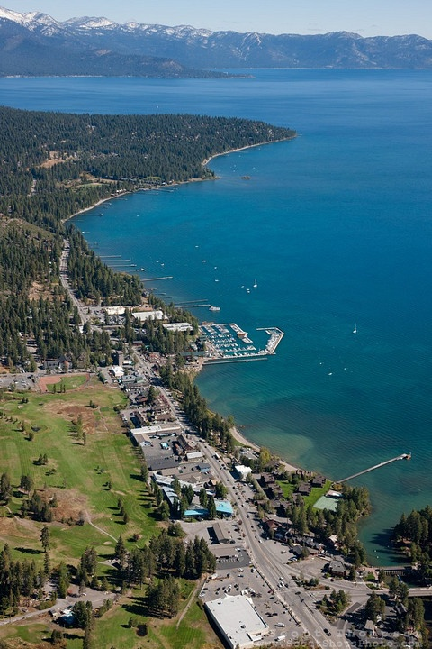 """Tahoe City Aerial 2"" - Aerial photograph of Tahoe City and Lake Tahoe, shot from an amphibious seaplane with the door removed."