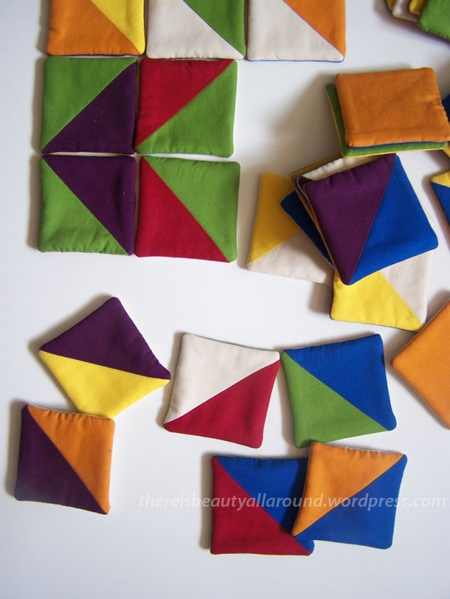 Tangram-esque fabric puzzle. would be fun to do this out of felt scraps (would minimize the sewing time). Just zig-zag down the centers.
