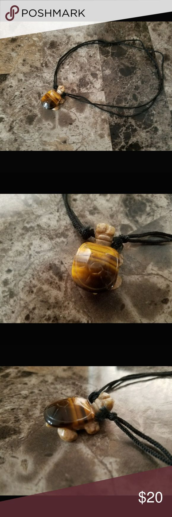"""Stone turtle necklace Never worn. Stone turtle necklace. Not remembering which kind of stone it is, but very cute! Is kept on a single string that is tied into knots on itself so you can move the knots from 15"""" or longer. Not hot topic. Hot Topic Jewelry Necklaces"""