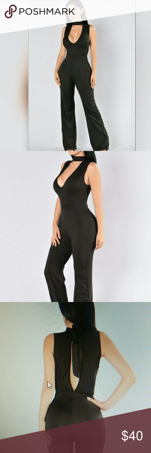 Sophisticated Lady Jumpsuit Gorgeous black jumpsuit, with a mock neckline a deep v cut and a keyhole back, gorgeous for any event. 94% polyester and 6% spandex Fashion Nova Other