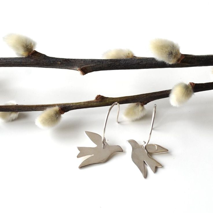 Earrings from Syster P with beautiful birds, set in sterling silver, also available in gold.