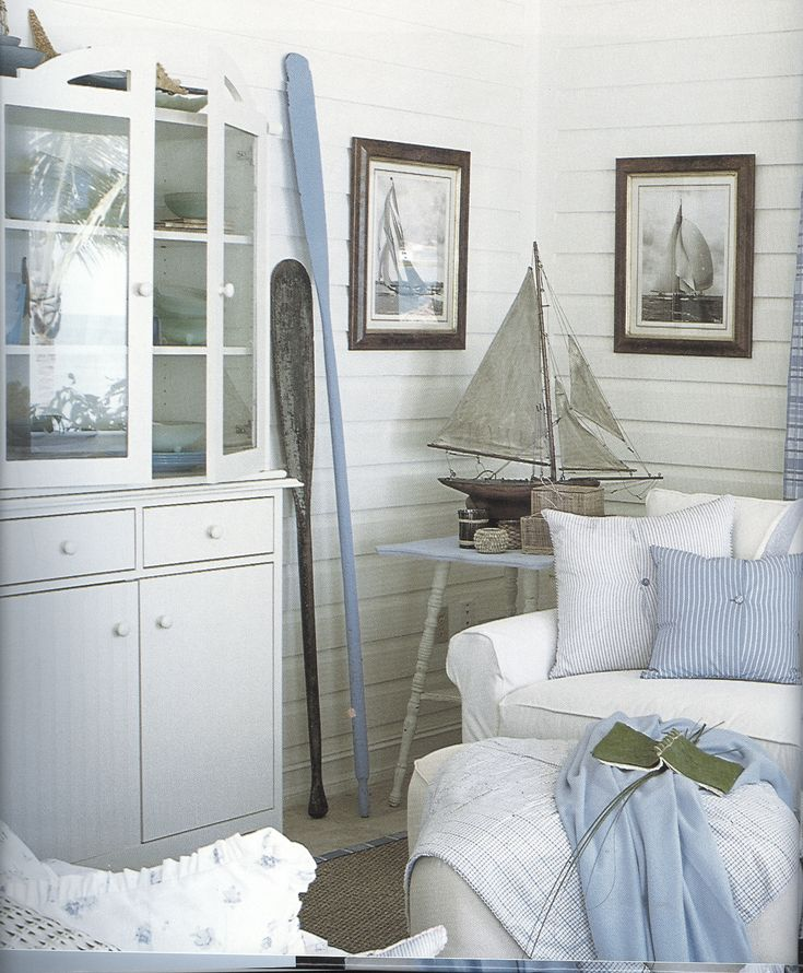 blue & white coastal decor. like the white wall panelling. the pictures of real sailboats near the model is a cool effect. The oars painted to coordinate really add a lot too. they could be mounted on the wall.
