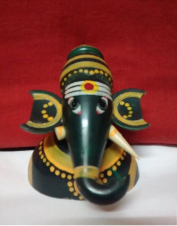A beautiful handcrafted wooden statue of Lord by PattachitraNet
