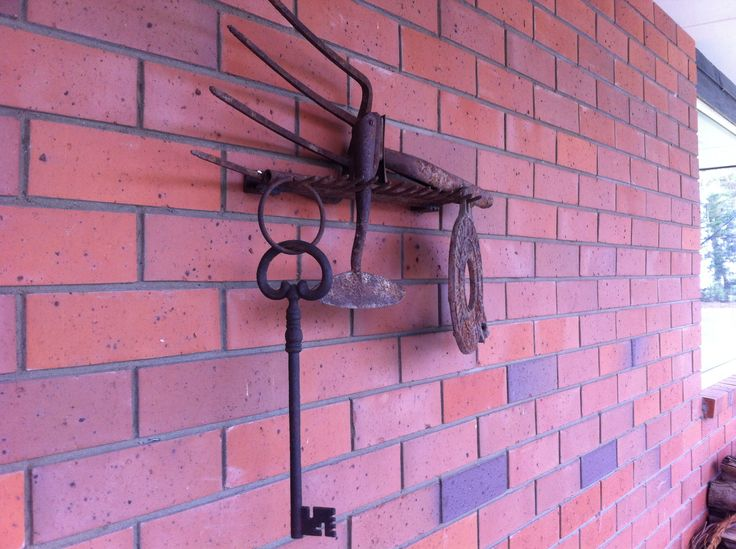 One mans junk looks great on my brick wall! Old rusty tools out of a skip...