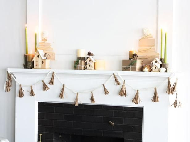 Blogger Challenge: HGTV Holiday House Fireplace Mantel Design: Emily Fazio's Christmas mantel mixes a simple Scandinavian aesthetic with natural wood details. See her entire fireplace mantel design here. From DIYnetwork.com