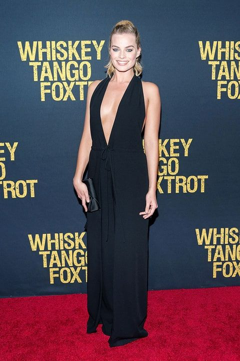 Margot Robbie wowed in a plunging jumpsuit for the premiere of 'Whiskey Tango Foxtrot' in NYC. Watch on Us Weekly's Red Carpet Daily!