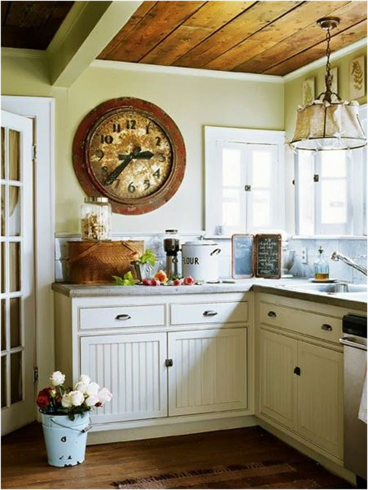 Small White Kitchen Country Cottage With A Large Vintage Clock On The Wall By Designer