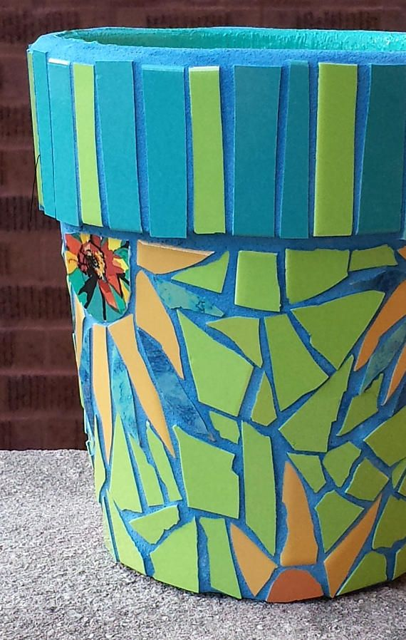 Outside or inside, this colorful and glowing MOSAIC FLOWER POT will brighten up your spirit as well as your home or garden. The combination of cerulean blue, lime green and mustard tiles make this sunflower themed mosaic pot glow. I imagine planting white daisies, marigolds or even green herbs like thyme or rosemary in this pot. Broken tile pieces in combination with some geometric shapes adds visual interest. The grout is also a bright cerulean blue which I have tinted (not dyed) with…