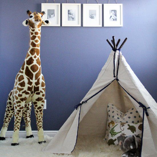 A modern twist on a safari themed kids room with stripes and a teepee!