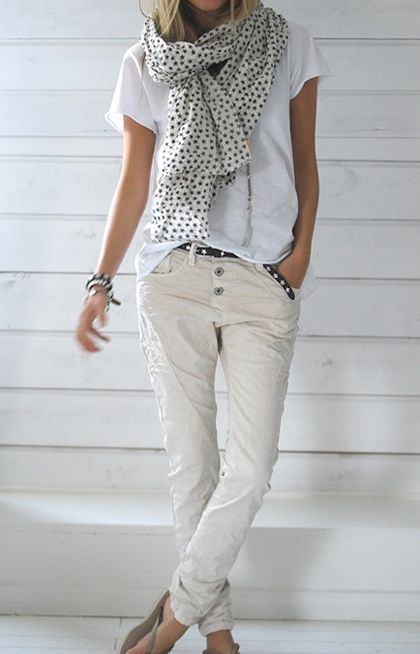 Woman wearing skinny cargo pants and  scarf plus T-shirt great for casual office…