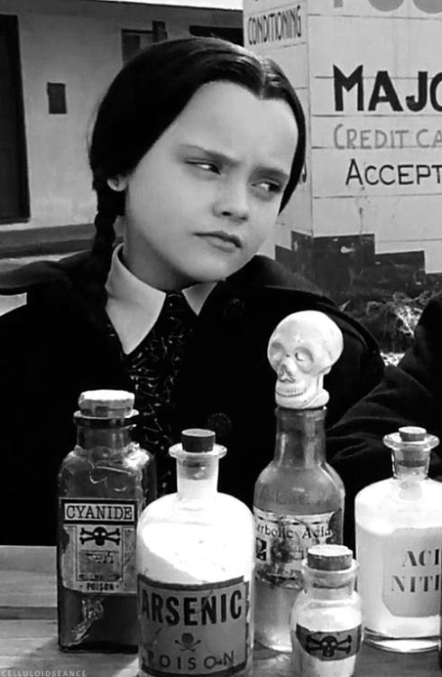 ~WEDNESDAY ADDAMS WITH HER POISONS ...CHRISTINA RICCI