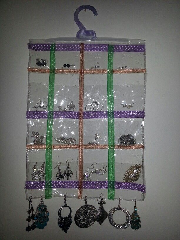 Wow look at this creative idea.. self made jewelery organiser made with some old plastic and ribbons- by Chanelle Goncalves