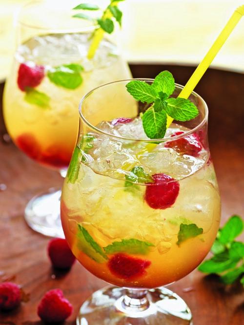 The Bruja Smash, mint leaves, raspberries, white tequila, Strega, lemon juice, over crushed ice