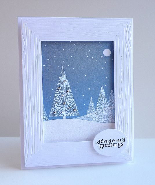 blue winter card ... absolutely gorgeous!!! ... luv the popped white frame that was embossed in a wood grain folder ... shimmer and shine ... lacey trees and a tiny  moon ...