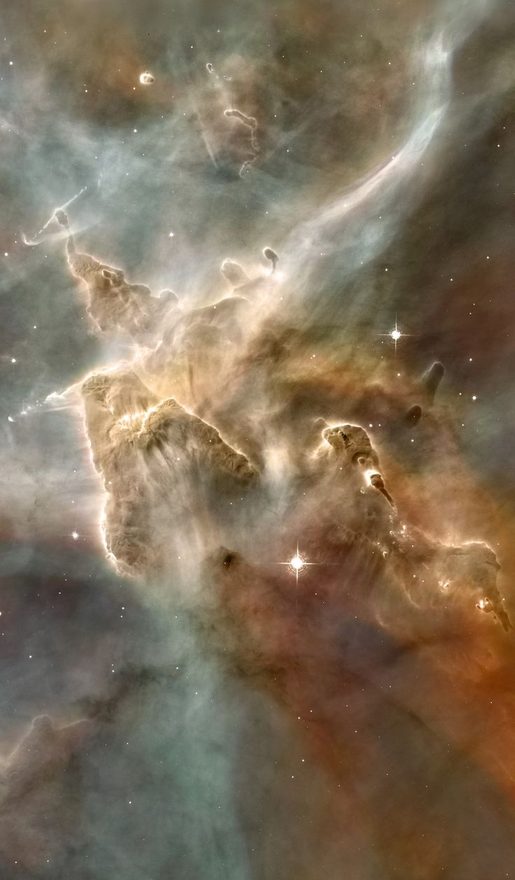 "Inside the Carina Nebula: Cropped from original 465 mb tif image. A towering ""mountain"" of cold hydrogen gas laced with dust is the site of new star formation in the Carina Nebula (NGC 3372). The great gas pillar is being eroded by the ultraviolet radiation from the hottest newborn stars in the nebula. This portion of the Carina Nebula is home to some of the most intense star formation in the Milky Way galaxy. Credit: NASA/Hubble"