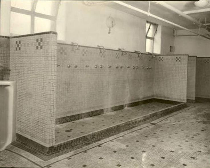 The guild hall restroom would only be partially communal  The showers and  toilets would be separate  I would build it as simply as possible  The si. The guild hall restroom would only be partially communal  The