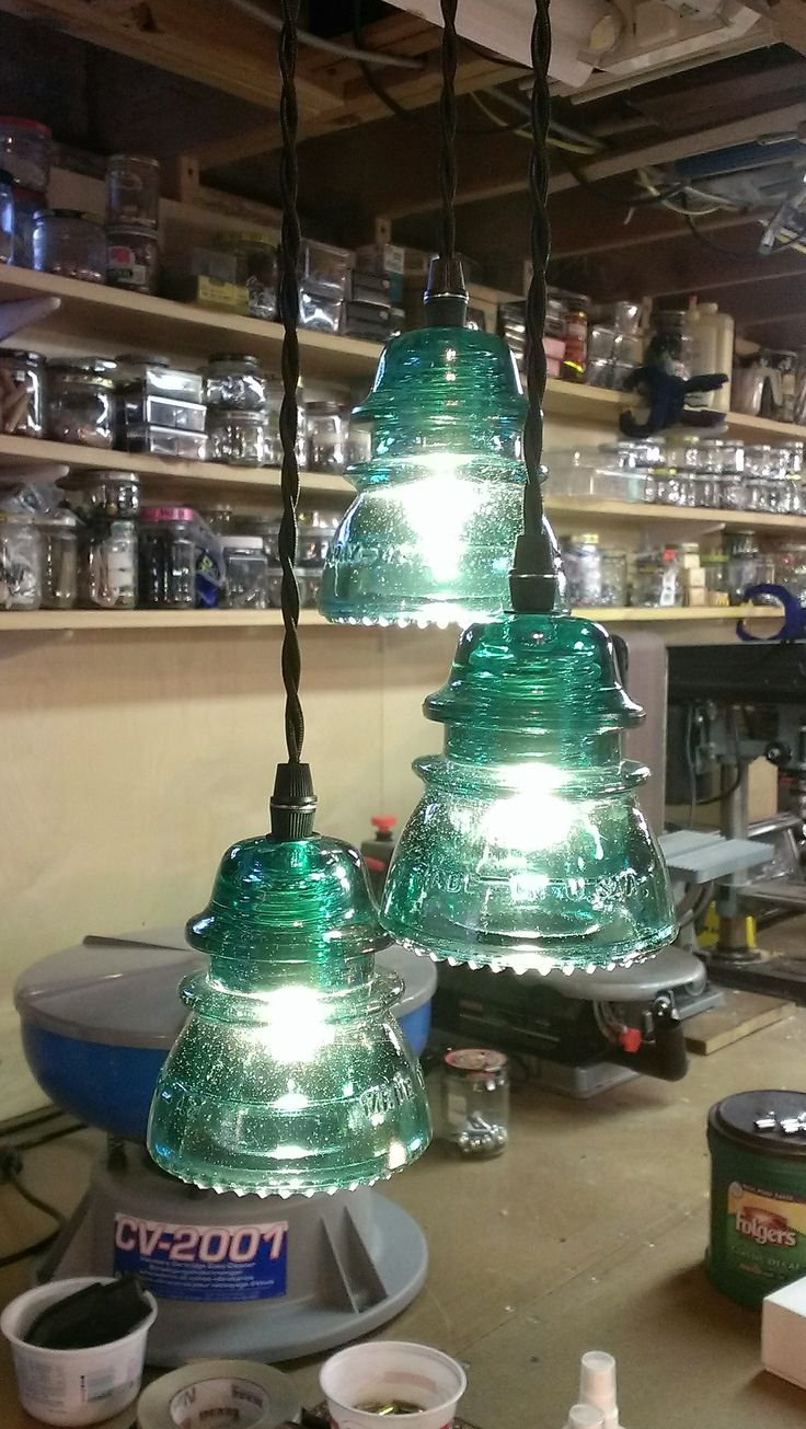 Antique Insulators repurposed into lighting, authentic vintage glass paired with modern wiring for a remarkable home accent lighting piece. 3 Insulator Pendant fixture, here with TEAL/BLUE/GREEN insulators, with standard black canopy (mounting kit w/ strain reliefs provided). Wiring is knotted and has extra length for installation and adjustment by electrician. Jack Riley Lighting and Metalworks – Contact us at JackRileyLighting@yahoo.com