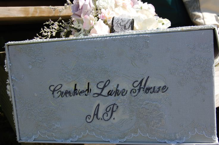 Soft silver lace covers the bottom portion of this box.  The wedding venue appears on the side.