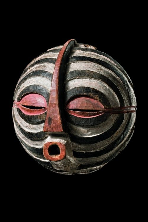 Kifwebe mask from the Luba People of D.R. Congo (mid 1900s). Wood, red, white & black paint, 13 in. The grooves symbolize animals with striped skin, like porcupines, zebras or antelopes. The round masks were especially danced at funerals of important persons. via Zemanek-Münster Auktion