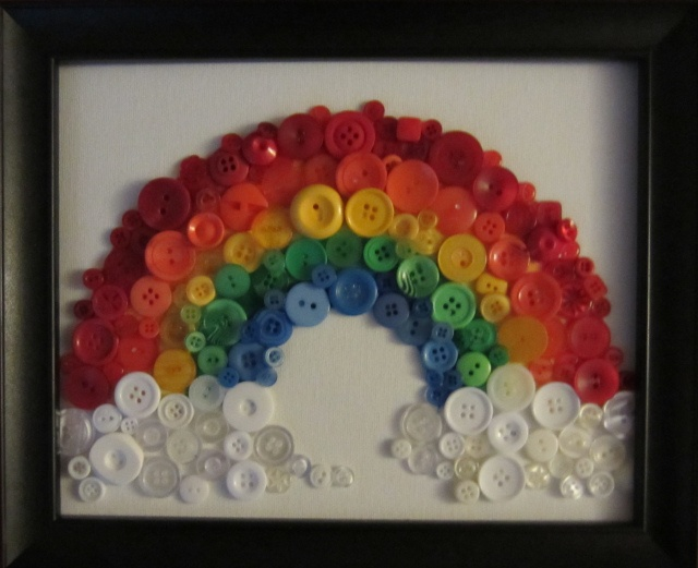 DIY Button Rainbow. Kids will love making this unique rainbow and hanging it on their walls. Another charming rainbow decor idea for your kids is a Rainbow canvas with their name written on it. You can find it here: http://www.mybellapearl.com/personalized-over-the-rainbow-wall-canvas/