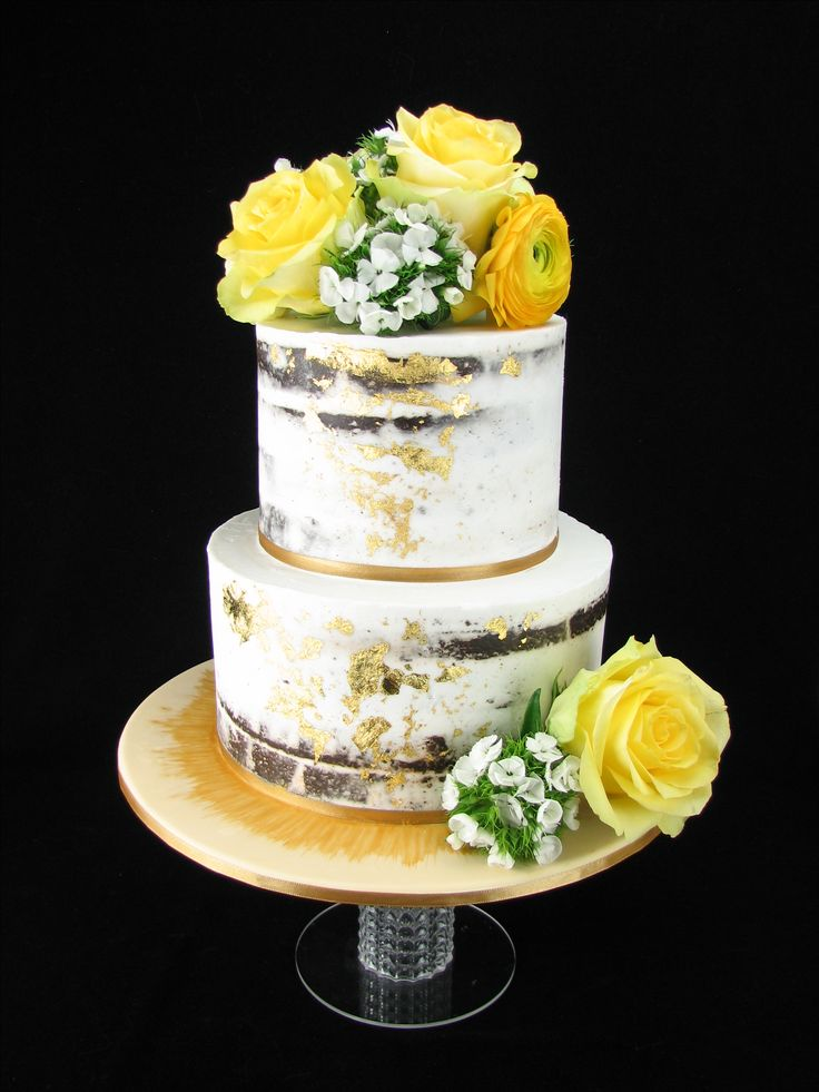 This cake is for a 50th Wedding Anniversary celebration. It is chocolate mud cake with buttercream and a touch of gold leaf and a gorgeous selection of roses, ranunculus and sweet william from Peony&Weasle — with Peony&Weasel Flower Co.