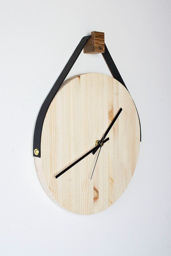Made from pallets, this rustic colourful wooden wall clock hangs direct from a leather strap, offered in 5 different colours giving your wall a: