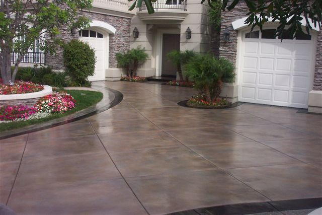 Stain concrete (or colored concrete) can improve the look of your old gray patio. In fact, concrete stains can improve the look of all concrete items, including driveways and concrete buildings.