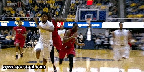 West Virginia basketball player Brandon Watkins gives the double middle finger
