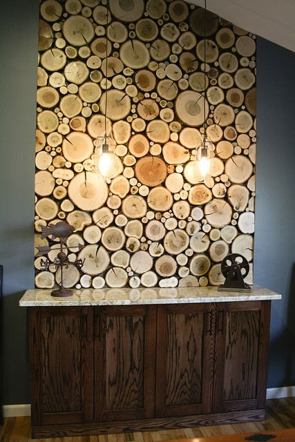 Create a similar wall panel of logs using log tiles from www.thelogbasket.co.uk.: