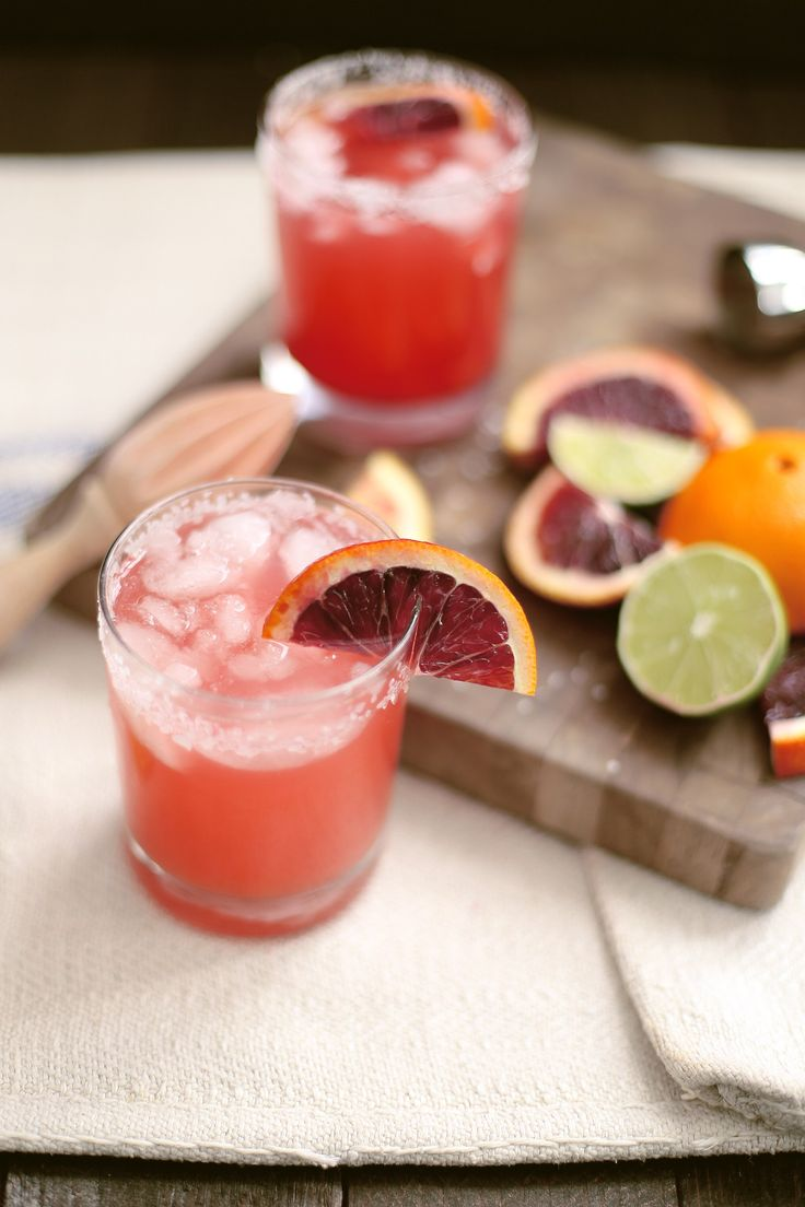 BLOOD ORANGE MARGARITA  INGREDIENTS: 3 Ounces of blood orange juice  1 Ounce of lime juice  2 Ounces of silver tequila  2 Tablespoons of simple syrup or Agave  Kosher Salt + Sugar for rim  Crushed Ice