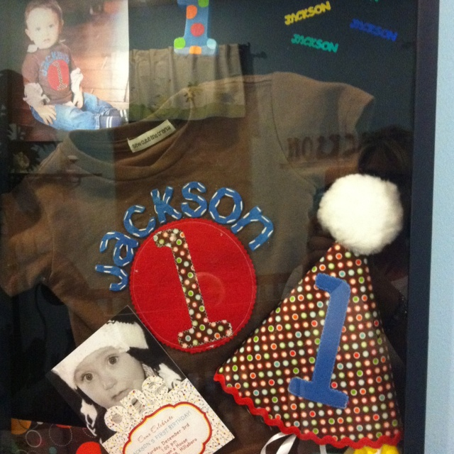 First birthday shadow box. I want to do this with Presleys 1st birthday stuff