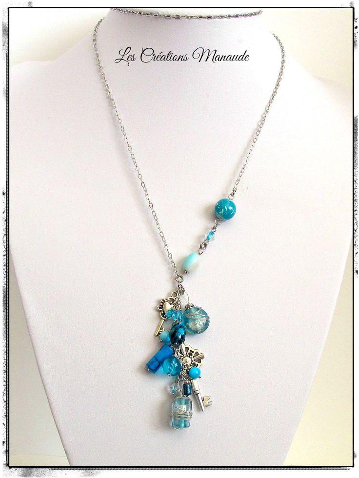 Collier de pierre verre  de couleur turquoise , breloque clé. chaîne acier inoxydable . 20$