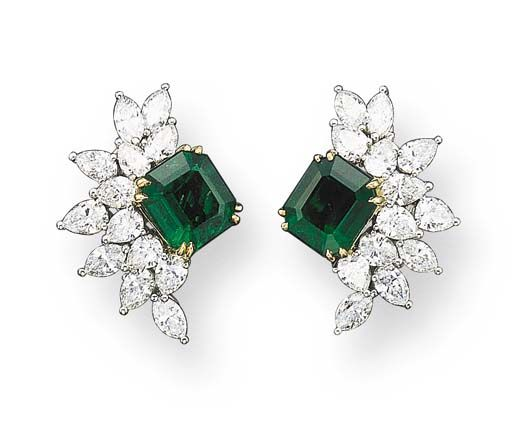 A PAIR OF EMERALD AND DIAMOND EAR CLIPS, BY TIFFANY  CO.   Each set with a rectangular-cut emerald weighing approximately 3.74 and 3.11 carats, enhanced by a marquise and pear-shaped diamond frame, mounted in 18K gold and platinum, in a suede box  Signed Tiffany  Co.