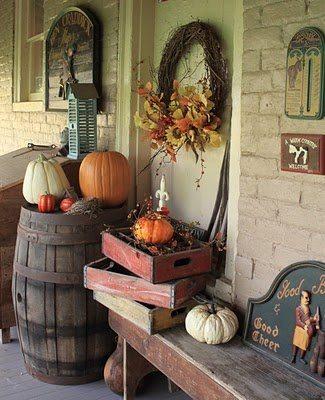 Create a setting on porch using barrels and pepsi crate and pumpkins.