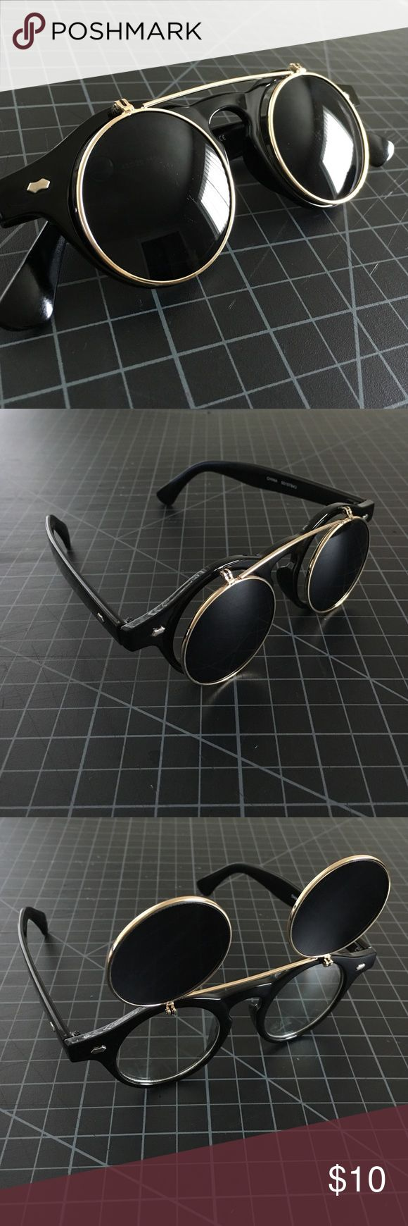 Retro style Flip Up Sunglasses Black sunglasses with flip up gold hinge. Cams be worn as fashion glasses or sunglasses. Forever 21 Accessories Sunglasses
