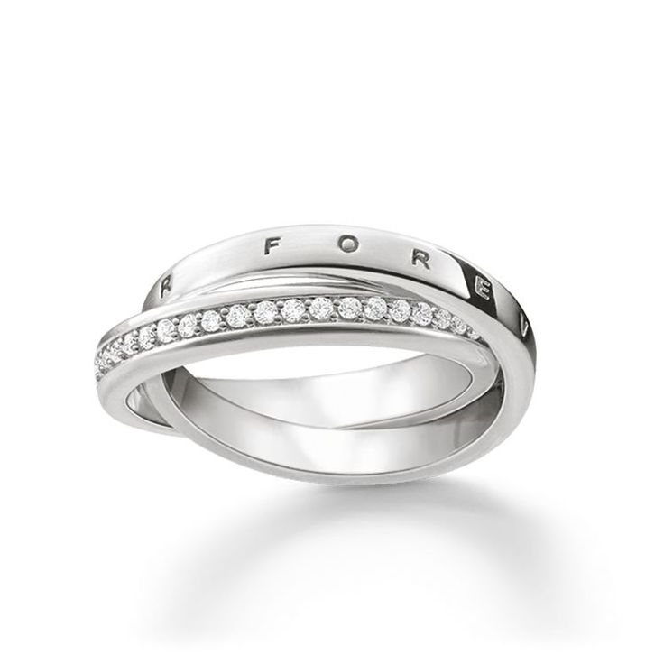 THOMAS SABO ring from the Sterling Silver Collection. United forever – the intertwined rings in 925 Sterling silver represent the inseparable bonds of two lovers. The engraving Forever Together / Together Forever on one of the rings strengthens its symbolic power. The other ring sparkles with white zirconia pavé. [Artikeltabelle]Category:ring Material:925 sterling silver Stones:zirconia white pavé Measurements:width approx. 0,7 cm (0,3 Inch) Itemnumber:TR2099-051-14[/Artikeltabelle]...