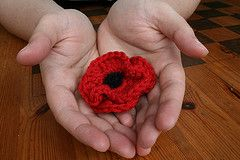 Poppy brooch Originally uploaded by kittyboo crochet A little poppy brooch, made by me, using Rowan Cashsoft yarn. Here is the (very rough and ready) pattern using UK terms: Make 2. Ch 6. SS into 1...