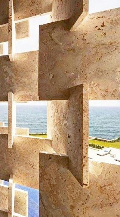 """If this wall were a floor, it might be a nightmare to sweep and keep clean. Why? Because of the natural pores that are commonly found in travertine. However, turning raw travertine into a smooth surface is """"easy peasy"""": https://www.lustroitaliano.com/stone-filler-adhesive-s/1873.htm"""