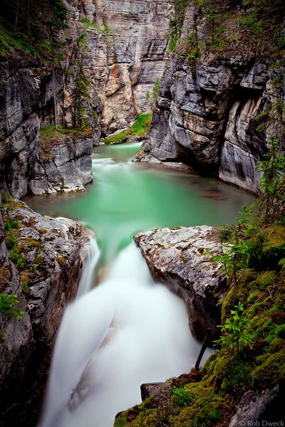 An overcast day proved to be the perfect weather for the easy stroll through Maligne Canyon that resulted in this photo. The diffused light combined with my 10 stop neutral density filter allowed for a 141 second exposure that blurred the emerald green water of the Maligne River to a silky flow.  (Not my photo)
