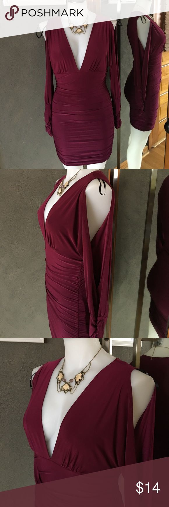 Wine color slit long sleeve shirred bodycon dress NWOT beautiful wine colored dress in slinky material, shirred from waist down for an adjustable length, bare shoulder- slit open sleeve from shoulder to wrist then ruched at wrist. V low neckline. Never worn-no damage no flaws. Skirt part is lined with another layer of fabric for no show. 94%polyester 6% spandex so it does have some stretch Forever 21 Dresses Long Sleeve