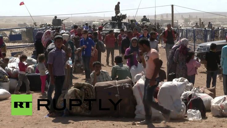 Turkey: Kurds flee across Syrian border as US launches airstrikes