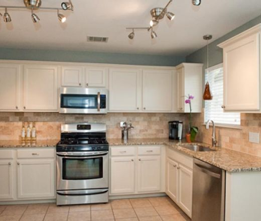 Transitional l shaped light blue kitchen cream cabinets for Kitchen cabinets 4 less