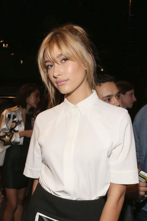 Have no idea what to do with your grown-out bangs? Middle-part your hair and trim the center just a tiiiiiny bit to ease out the awkward phase.