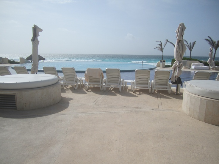 The infinity pool and two of the outdoor hot tubs at the Live Aqua Resort in Cancun.  The beach is right on the other side of the infinity pool.  Powder white sand and drink service on the beach- what more could you ask for?  Let me arrange a quote for you: http://abtqr.blogspot.com or swabt@comcast.net.