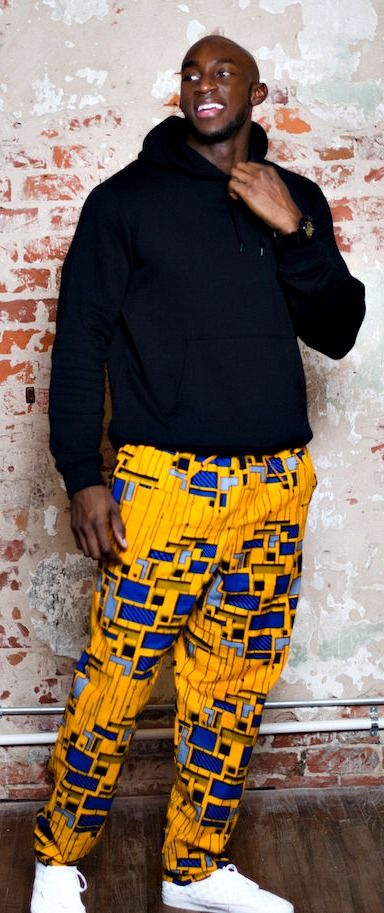 The Ade pants are cut for a unisex fit that is slightly oversized for her, and a relaxed comfortable fit for him. African print pants, men's African print pants, drawstring pants, ankara pants with pockets - The Ade Drawstring Pants. Ankara | Dutch wax | Kente | Kitenge | Dashiki | African print bomber jacket | African fashion | Ankara bomber jacket | African prints | Nigerian style | Ghanaian fashion | Senegal fashion | Kenya fashion | Nigerian fashion | Ankara crop top (affiliate)